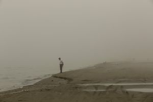 Man standing at the shore.