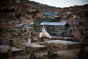 A child runs through Sakhi cemetary in Kabul. © Michael Christopher Brown