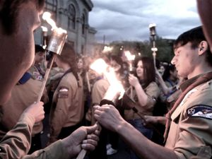 Scouts lighting their torch at the 23rd April evening demonstration dedicated to the victims of the genocide.