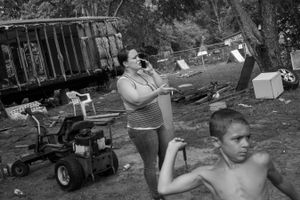 Misty, 37, and her son, Michael, in the front yard of family property.