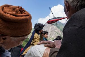 The helicopter from aid agency leaves Gumba village after the second 7.3 magnitude earthquake hit the area