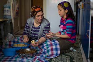 With her grandchild  Nupelda Tosun.