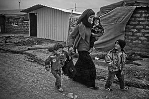 Mother takes her children to walk inside the camp. Everyday they went to visit their relatives and other family members to their tent. © Khaled Hasan