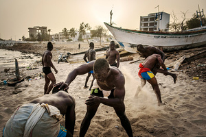Young Wrestlers train during the evening hours at Boy Kaire's wrestling school on the beach of the Corniche of Dakar, March 31, 2015.