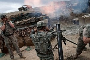 U.S. soldiers from the 1st Infantry Division fire mortars on suspected insurgent positions, at the Korengal Out Post (KOP), in the Korengal Valley, Afghanistan on April 1, 2009. © Adam Ferguson