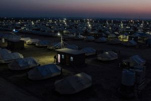 22/01/2015 -- Kirkuk, Iraq -- A view of Laylan IDP camp at night. Laylan camp is 20 KM south of Kirkuk. UNHCR and the municipality of Kirkuk built the camp with around 1500 tents. Around 8450 people live in the camp. Metrography IDP project is funded by Free Press Unlimited