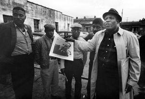 """Big Lester"" among the Longshoremen, Longshoremen's Hall, Savannah, Georgia, 1963 © Frederick C. Baldwin"
