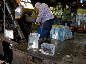 loading huge blocks of ice into the mill