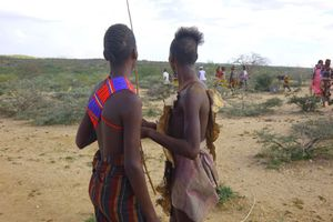 10. The two brothers remain alone in the field, exchanging experiences and watching the tribesmen returning to their village.