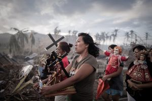 1st Prize Spot News Single. Survivors of typhoon Haiyan march during a religious procession in Tolosa, on the eastern island of Leyte. One of the strongest cyclones ever recorded, Haiyan left 8,000 people dead and missing and more than four million homeless after it hit the central Philippines © Phillipe Lopez, France, Agence France-Presse
