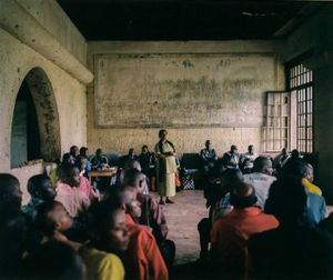 """Henriette Useni Kabake, Lulingu's government administrator, hosts a town meeting alongside traditional and RM leaders inside a decayed building from the Belgian colonial era. The RM insist they should not be labeled """"rebels"""" like other armed groups operating in Congo, citing that they have not interfered with the work of government officials in their territory. © Diana Zeyneb Alhindawi"""