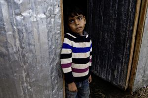 Child waiting to go to the toilet facilities. © Tom Verbruggen