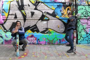 Graffiti artists at Dénoyez street, Paris