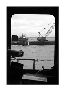 Steaming past the fuel barge