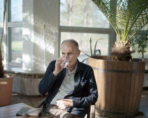 Dad drinking water believed to have healing properties