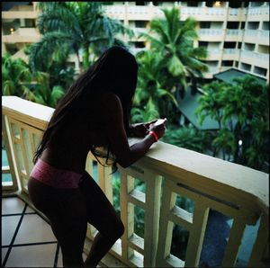 Sahomy checking messages while working at a resort near Santo Domingo