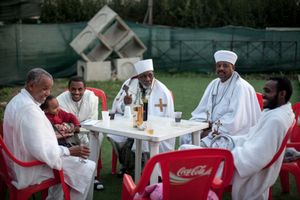 After St. Michael's Day services, the Eritrean Orthodox Tewahdo community attends a communal lunch at an outdoor theatre near Via Collatina in southeast Rome.