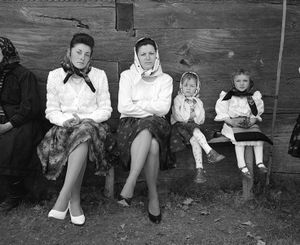 Easter Sunday, Sirbi, 2000. Fashion has changed as women replace the homespun black in their skirts with factory printed fabric and given up their leather and wool opincithe footwear of traditionfor vinyl pumps. What remains constant is Sunday afternoon, when one learns to flaunt ones sense of style. © Kathleen Laraia McLaughlin.