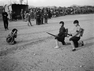 © SHA Fei (1912-1950), Chen Bo photographs the training of local militia women, 1938Courtesy of WANG Yan