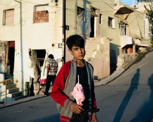 Akram Oman, 14, is from Rakka . He arrived two weeks ago with his family - running from Isis. He lives in an abandoned house with no electricity or running water and collects plastic with his brothers and sisters.24