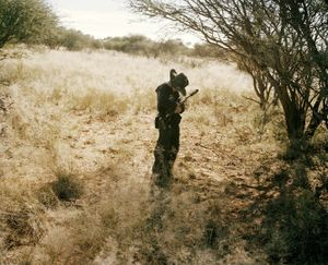 young hunter # II, kalahari, northern cape, south africa-from the series 'hunters'-David Chancellor