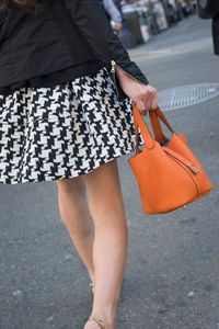 Lady with Orange Bag