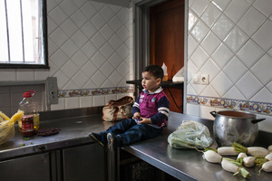 "Casablanca, March 2015. This child waits for his mother while she is finishing working in the kitchen of the restaurant of the NGO ""Solidarité Feminine"". Many of the girls have the opportunity to work and care for their children, inside the Association."