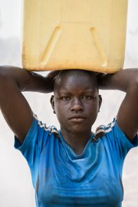 Akello Shara: Carries a 5 gallon Jerrycan of water (41 lbs) for home use twice a day.