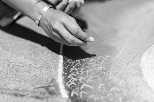 Chalk artist's hand in New York