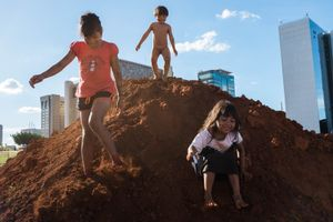 Indigenous children play in the  camp