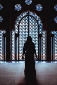 Praying silhouette.