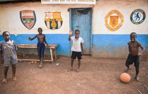 Children play football in a small village in Sierra Leone.