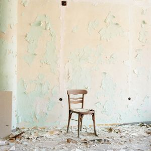 Chair in damaged office, Borovo shoe factory. © Colin Dutton