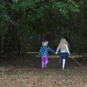 The Girls Skipping Through the Privet Tunnel into the Woods