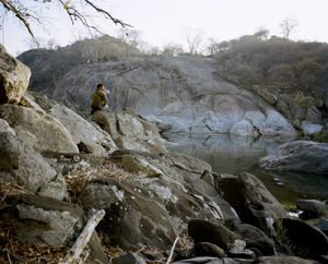 untitled hunter, at dawn, hippo pool, zimbabwe-from the series 'hunters'-David Chancellor