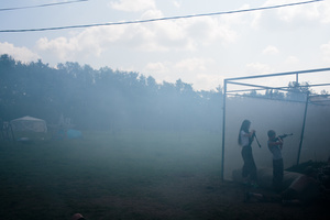 A fake grenade is launched, setting smoke in the atmosphere as students practice a drill with air-soft guns at  the Historical-War Camp, in Borodino, Russia. 29 July 2016. 350 adolescents are in attendance, ranging in ages from 11 to 16, and lasts throughout the summer. Students learn a variety of skills from tactical training in handguns, loading and unloading automatic guns, physical endurance,