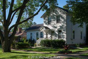 White Farmhouse with Tree