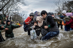 "Migrants cross the river ""Konska"" on the Macedonia - Greece borders after leaving the Idomeni refugee camp on March 14, 2016."