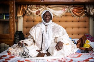 November 8, 2017 – Serigne Cheikh Seye Baye, 69, poses for a picture at the house of his Dahira in Touba during the Grand Magal 2017.  Cheikh Seye is also a renowned shaman doctor and healer. He is also a Marabout of the Baye Fall Brotherhood, a clergyman and scholar and the spiritual leader of a Dahira, as smaller religious communities within the Senegalese Sufi brotherhoods are called.