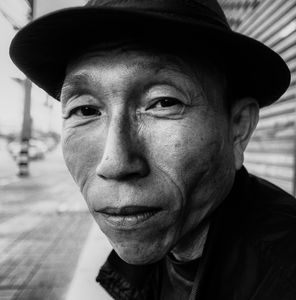 Man sitting on a bench in Chiang Mai, Thailand.