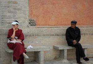 Encounter at the bench. Kumbum monastery, Xining, China. 2009.