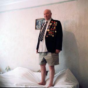 Iosif Kruglyak, showing the portrait of his parents (2010)
