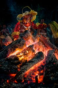 Dancing around the embers is an important element in the dialogue between Theyyam performers and their celestial self.