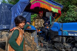 Young boys work as  tractor driver that deliver relief materials to Barpak (1st epicentre), Gorkha district.
