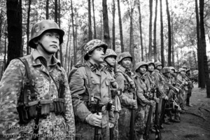 Indonesian men dressed up as German Waffen-SS soldiers stand in formation during a gathering of re-enactment enthusiasts in Cibubur, East Jakarta, Indonesia.