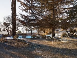 Swingset and Pool at Burnt Home, California