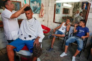 Miguel at a barber shop, Havana © Mariette Allen