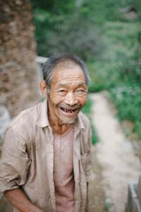 Happy man on mountain trail. China