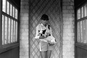 Girl with the French Bulldog on hands