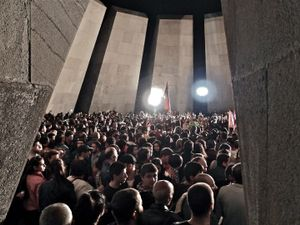 At the end of the 23rd April demonstration, participants gather within the sanctuary of the Tsitsernakaberd memorial.